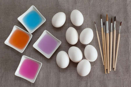 Colored water and brushes for decoration Easter eggs photo