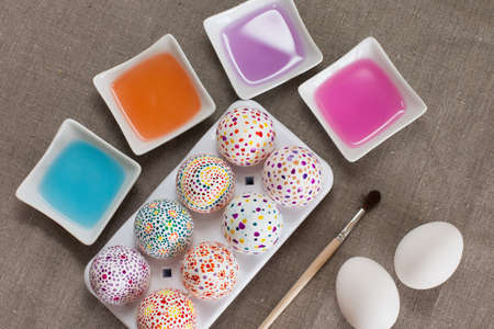 Painting Easter eggs, colored water and brush photo