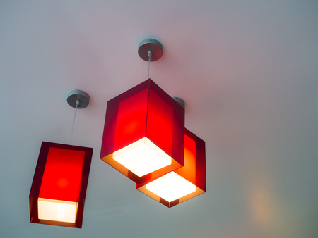 Three red hanging lights in an apartment Stock Photo