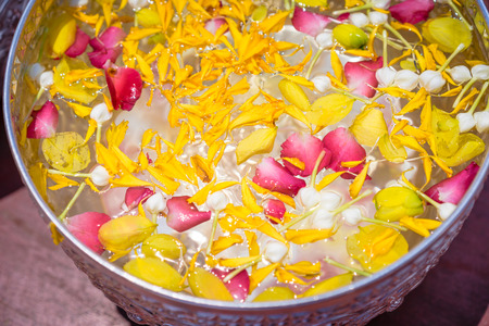 Floating flowers in aluminum bowl for festival in Thailand