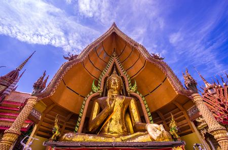 Big gold buddha statue and blue sky