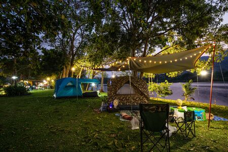 Camping and tent in nature park at evening time 写真素材