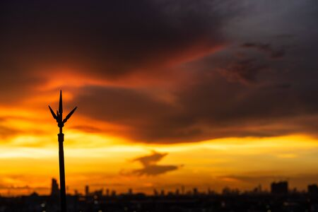Lightning rod on the rooftop of condominium with colorful sky 写真素材
