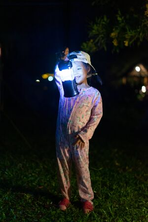 portrait of Little girl with lightning at the night