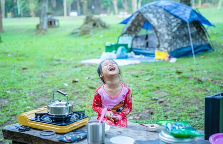 little girl have fun during camping
