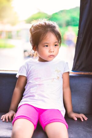 Little girl travels on a train and looking