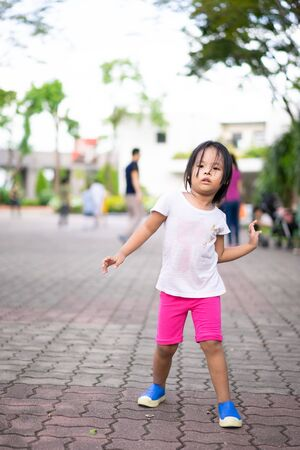 Little girl exercise by aerobic dance in the park