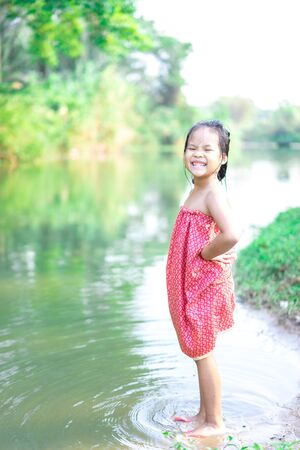 asian little girl prepare to playing in nature water