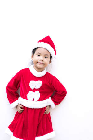 little asian girl in red Santa Claus costume on white background