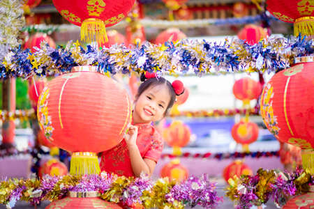 cute little asian girl in chinese traditional dress smiling in the temple.Happy chinese new year concept. 版權商用圖片
