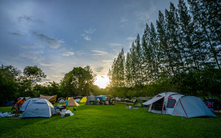 Ratchaburi, Thailand​ -​  July 26, 2020​ : Travelers come to camping in nature park with sunset on holiday