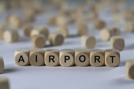 spaceport: airport - cube with letters, sign with wooden cubes Stock Photo