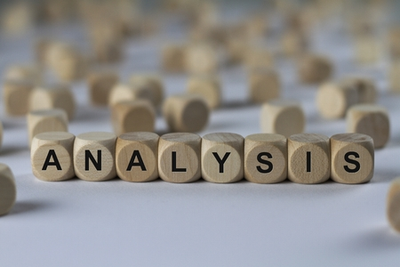 analysis - cube with letters, sign with wooden cubes Stock Photo