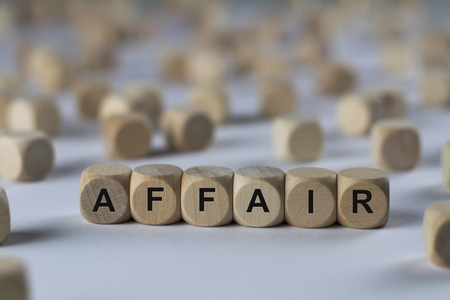 affair - cube with letters, sign with wooden cubes Stock Photo