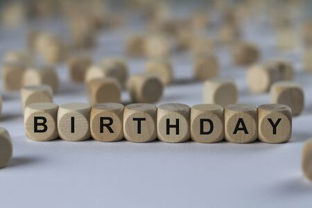 observance: birthday - cube with letters, sign with wooden cubes Stock Photo