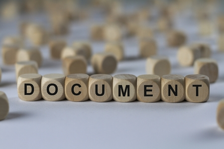document - cube with letters, sign with wooden cubes