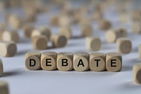 argumentation: debate - cube with letters, sign with wooden cubes