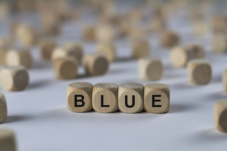dejected: blue - cube with letters, sign with wooden cubes