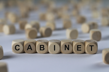 cabinet - cube with letters, sign with wooden cubes Stock Photo