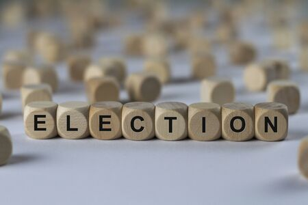 election - cube with letters, sign with wooden cubes
