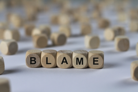 blame: blame - cube with letters, sign with wooden cubes