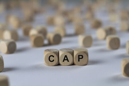 cap - cube with letters, sign with wooden cubes Stock Photo
