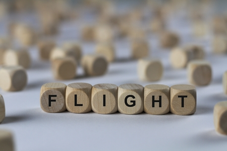 flight - cube with letters, sign with wooden cubes