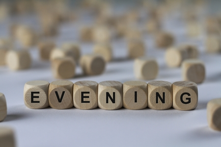 duskiness: evening - cube with letters, sign with wooden cubes Stock Photo
