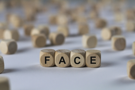 countenance: face - cube with letters, sign with wooden cubes