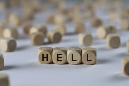 ordeal: hell - cube with letters, sign with wooden cubes Stock Photo