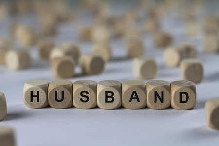 economise: husband - cube with letters, sign with wooden cubes Stock Photo