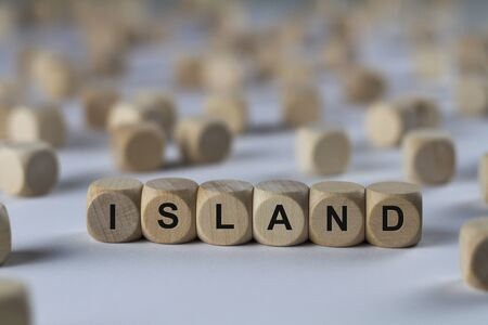 insular: island - cube with letters, sign with wooden cubes