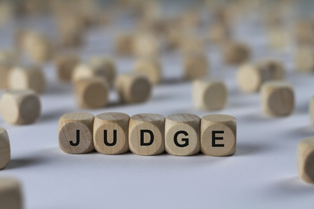 appraise: judge - cube with letters, sign with wooden cubes