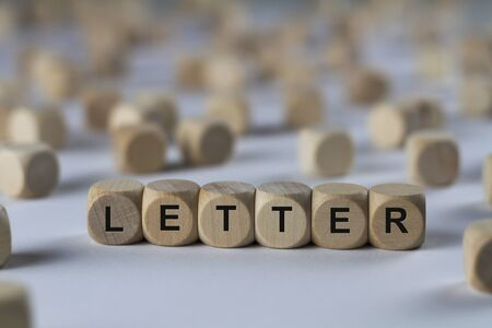 letter - cube with letters, sign with wooden cubes
