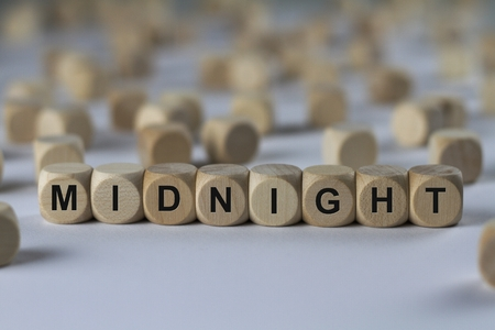midnight - cube with letters, sign with wooden cubes Stock Photo