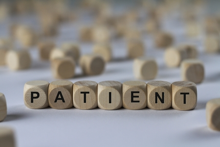 sufferer: patient - cube with letters, sign with wooden cubes