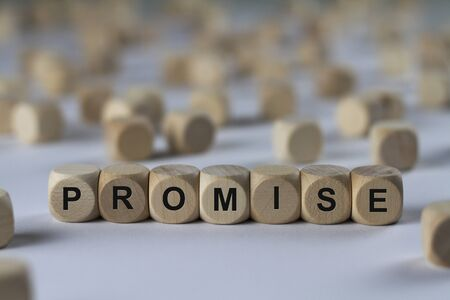 foreshadow: promise - cube with letters, sign with wooden cubes Stock Photo