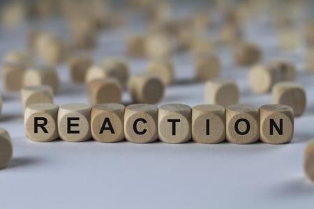 backlash: reaction - cube with letters, sign with wooden cubes