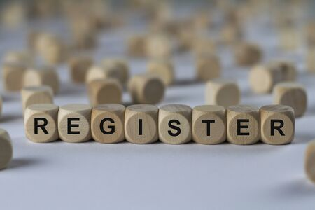 register - cube with letters, sign with wooden cubes Stock Photo