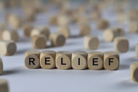 respite: relief - cube with letters, sign with wooden cubes