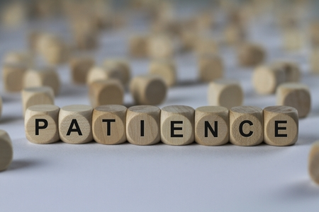 composure: patience - cube with letters, sign with wooden cubes Stock Photo