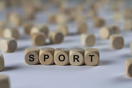 romp: sport - cube with letters, sign with wooden cubes Stock Photo