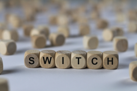 switch - cube with letters, sign with wooden cubes Stock Photo