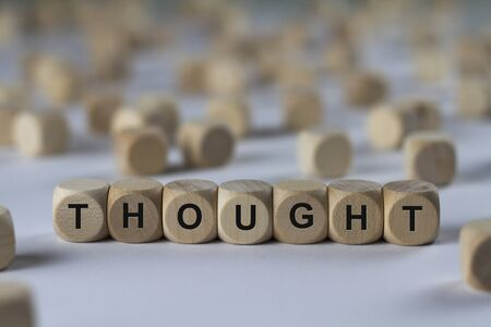 thought - cube with letters, sign with wooden cubes Stock Photo
