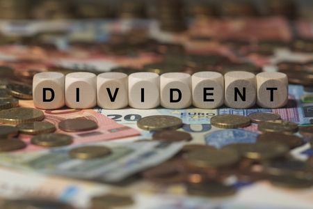 - DIVIDENT - image with words associated with the topic STOCK EXCHANGE, word cloud, cube, letter, image, illustration Stock Photo