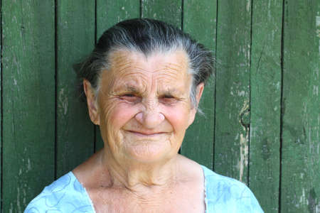 former years: Grandma is waiting for guests Stock Photo