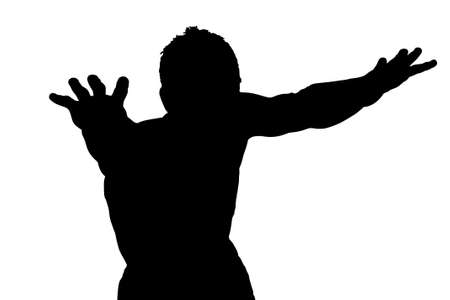 silhouette of a young boy with his hands up