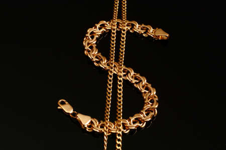 A gold bracelet and a chain