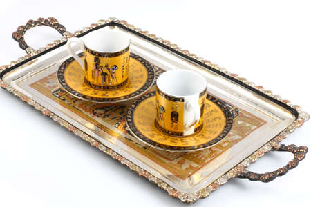 Silver tray with coffee cups Stock Photo