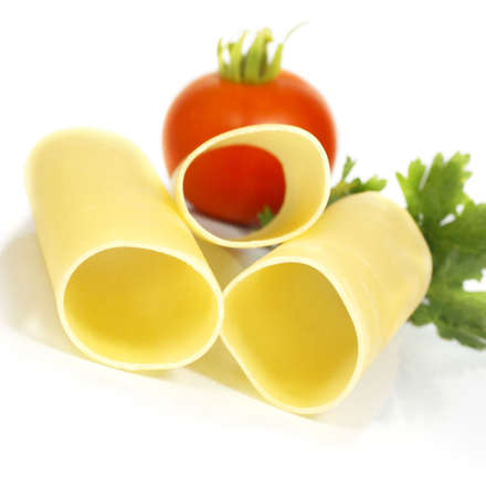 uncooked cannelloni for stuffing with tomato and herbs photo